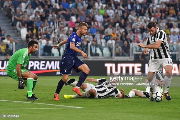 Andrea Barzagli of Juventus and Ciro Immobile of Lazio in action during the Serie A match between Juventus and SS Lazio on October 14 2017 in Turin...