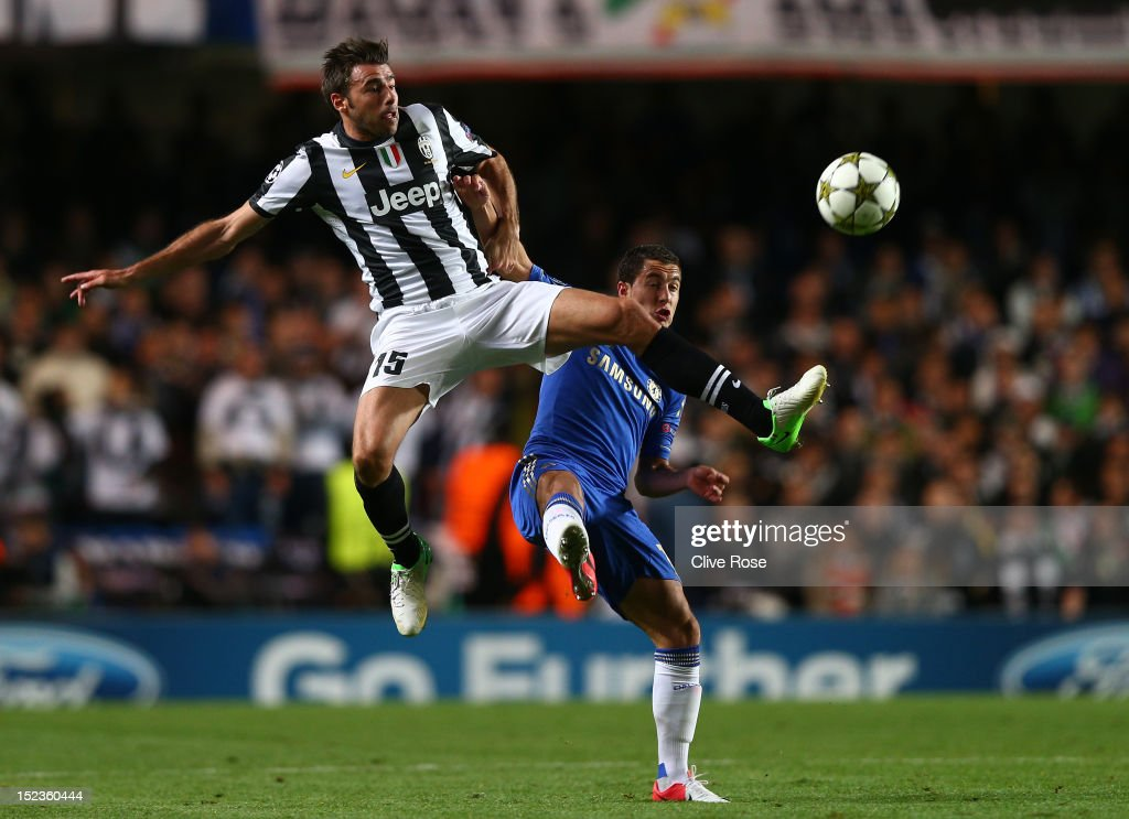 <a gi-track='captionPersonalityLinkClicked' href=/galleries/search?phrase=Andrea+Barzagli&family=editorial&specificpeople=465353 ng-click='$event.stopPropagation()'>Andrea Barzagli</a> of Juventus and <a gi-track='captionPersonalityLinkClicked' href=/galleries/search?phrase=Eden+Hazard&family=editorial&specificpeople=5539543 ng-click='$event.stopPropagation()'>Eden Hazard</a> of Chelsea compete for the ball during the UEFA Champions League Group E match between Chelsea and Juventus at Stamford Bridge on September 19, 2012 in London, England.