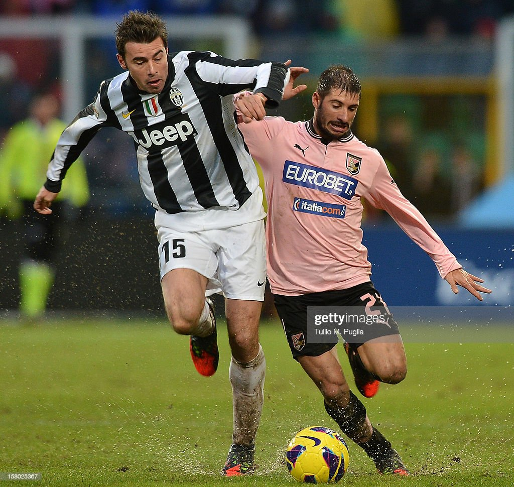 <a gi-track='captionPersonalityLinkClicked' href=/galleries/search?phrase=Andrea+Barzagli&family=editorial&specificpeople=465353 ng-click='$event.stopPropagation()'>Andrea Barzagli</a> (L) of Juventus and Franco Brienza of Palermo compete for the ball during the Serie A match between US Citta di Palermo v Juventus FC at Stadio Renzo Barbera on December 9, 2012 in Palermo, Italy.