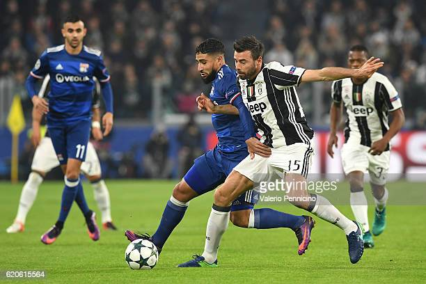 Andrea Barzagli of Juventus competes with Nabil Fekir of Olympique Lyonnais during the UEFA Champions League Group H match between Juventus and...