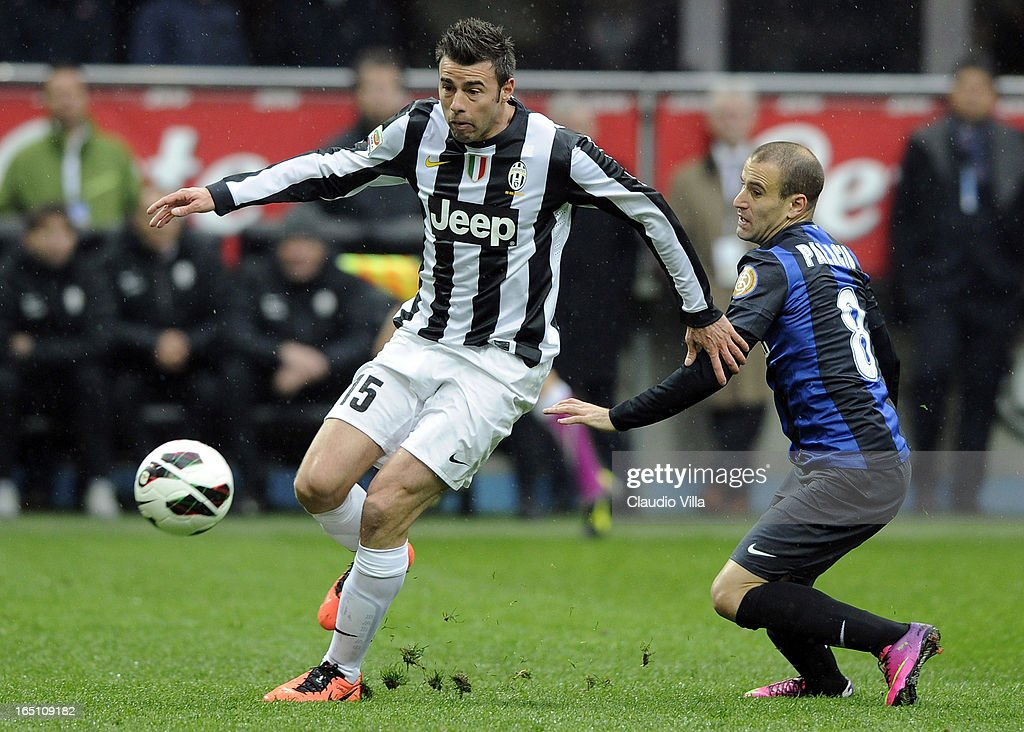 Andrea Barzagli of Juventus FC (L) and Rodrigo Palacio of FC Inter Milan compete for the ball during the Serie A match between FC Internazionale Milano and Juventus FC at San Siro Stadium on March 30, 2013 in Milan, Italy.