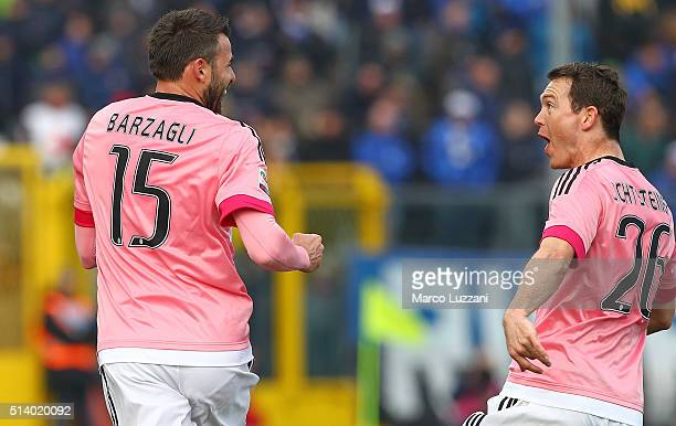 Andrea Barzagli of Juventus FC celebrates with his teammate Stephan Lichtsteiner after scoring the opening goal during the Serie A match between...