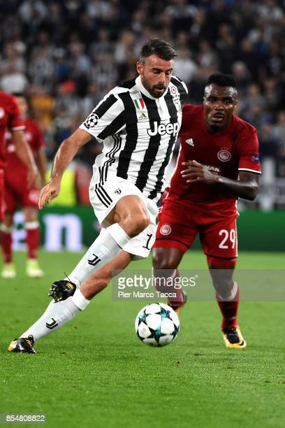 Andrea Barzagli of Juventus FC competes for the ball with Emmanuel Emenike of Olympiakos Piraeus of during the UEFA Champions League group D match...
