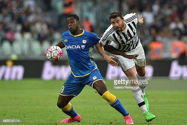 Andrea Barzagli of Juventus FC competes with Duvan Zapata of Udinese Calcio during the Serie A match between Juventus FC and Udinese Calcio at...