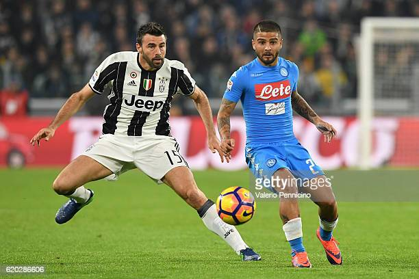 Andrea Barzagli of Juventus FC competes with Lorenzo Insigne of SSC Napoli during the Serie A match between Juventus FC and SSC Napoli at Juventus...