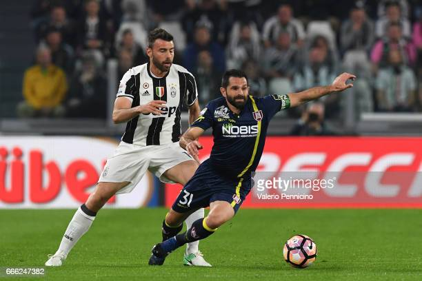 Andrea Barzagli of Juventus FC competes with Sergio Pellissier of AC ChievoVerona during the Serie A match between Juventus FC and AC ChievoVerona at...