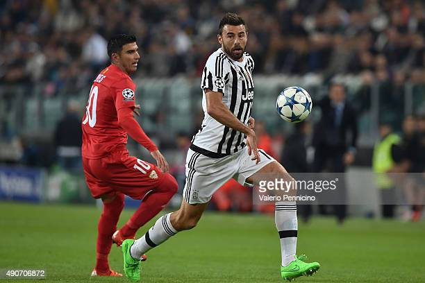 Andrea Barzagli of Juventus in action against Jose Antonio Reyes of Sevilla during the UEFA Champions League group E match between Juventus and...