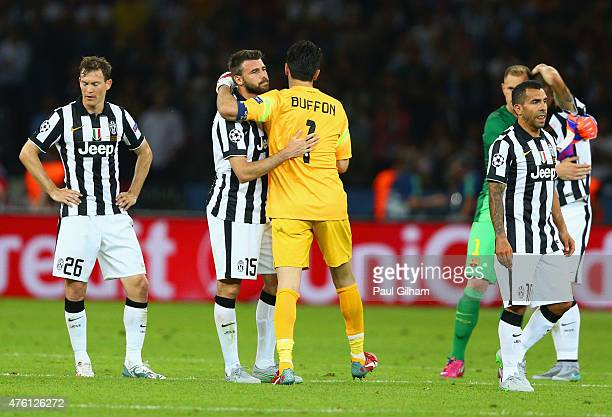 Andrea Barzagli of Juventus is consoled by Gianluigi Buffon after the UEFA Champions League Final between Juventus and FC Barcelona at Olympiastadion...