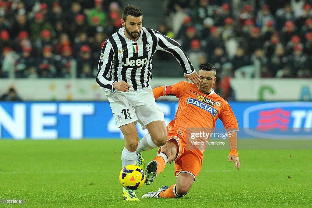 Andrea Barzagli (L) of Juventus is tackled by Antonio Di Natale of Udinese Calcio during the Serie A match between Juventus and Udinese Calcio at Juventus Arena on December 1, 2013 in Turin, Italy.