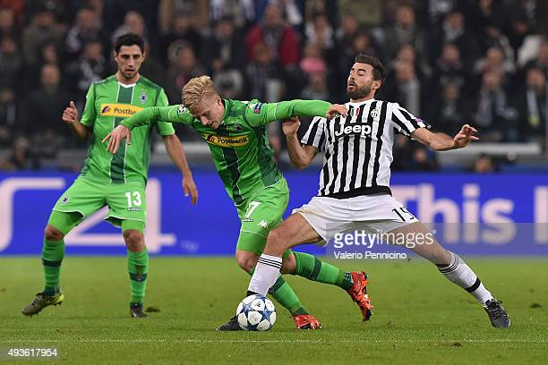 Andrea Barzagli of Juventus tackles Oscar Wendt of VfL Borussia Moenchengladbach during the UEFA Champions League group stage match between Juventus...