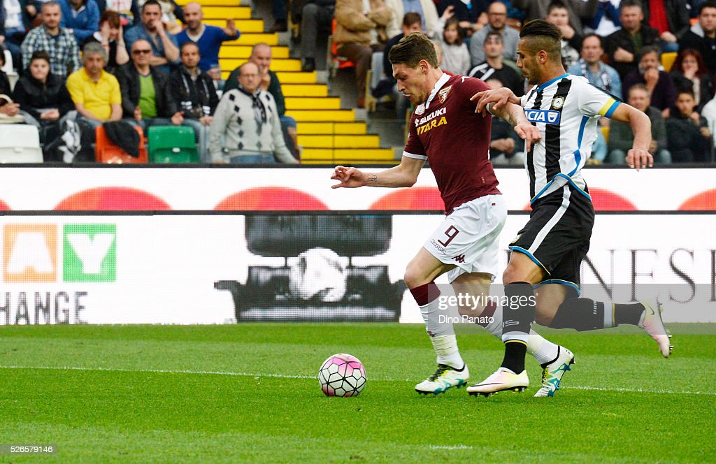 Andrea Bellotti (L) of Torino FC scores his team's fourth goal during the Serie A match between Udinese Calcio and Torino FC at Dacia Arena on April 30, 2016 in Udine, Italy.
