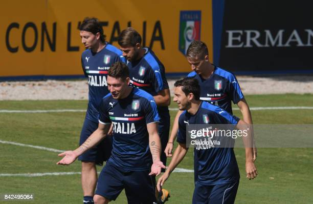 Andrea Belotti and Matteo Darmian of Italy chat during the training session at Italy club's training ground at Coverciano on September 04 2017 in...