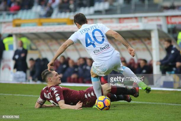 Andrea Belotti and Nenad Tomovic compete for the ball during the Serie A football match between Torino FC and AC Chievo Verona at Olympic Grande...
