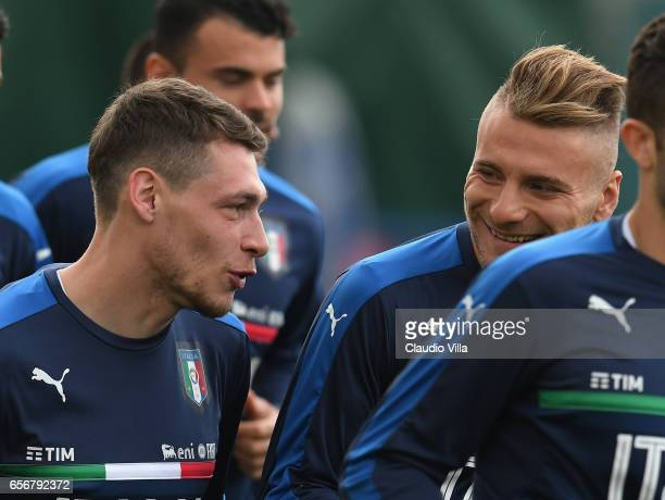 Andrea Belotti and of Italy chat during the training session at the club's training ground at Coverciano on March 23 2017 in Florence Italy