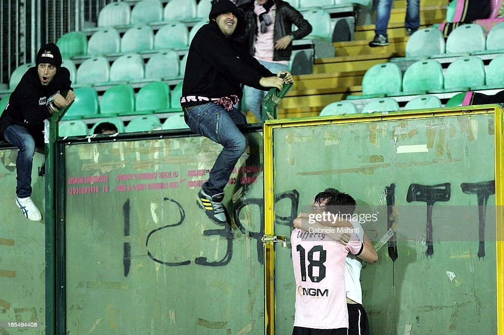 Andrea Belotti (R) celebrates with Kyle Lafferty of US Citta di Palermo after scoring the winning goal during the Serie B match between AC Siena and US Citta di Palermo at Artemio Franchi - Mps Arena on October 21, 2013 in Siena, Italy.