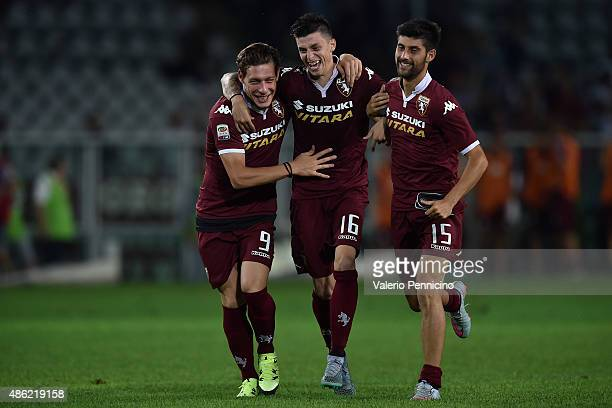 Andrea Belotti Daniele Baselli and Marco Benassi of Torino FC celebrate victory at the end of the Serie A match between Torino FC and ACF Fiorentina...