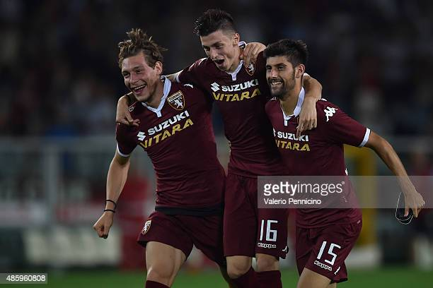 Andrea Belotti Daniele Baselli and Marco Benassiof Torino FC celebrate victory at the end of the Serie A match between Torino FC and ACF Fiorentina...