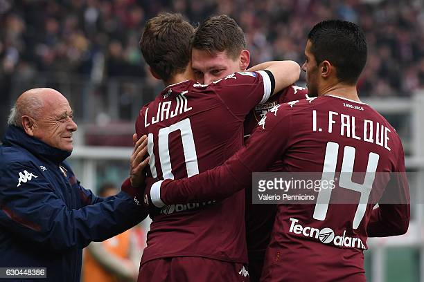 Andrea Belotti of FC Torino celebrates after scoring the opening goal with team mates Adem Ljajic and Iago Falque during the Serie A match between FC...