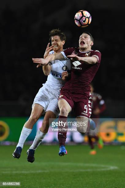 Andrea Belotti of FC Torino clashes with Cristian Ansaldi of FC Internazionale during the Serie A match between FC Torino and FC Internazionale at...