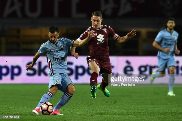 Andrea Belotti of FC Torino competes with Bruno Miguel Fernandes of UC Sampdoria during the Serie A match between FC Torino and UC Sampdoria at...