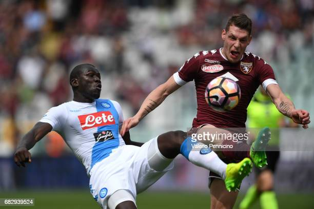 Andrea Belotti of FC Torino competes with Kalidou Koulibaly of SSC Napoli during the Serie A match between FC Torino and SSC Napoli at Stadio...