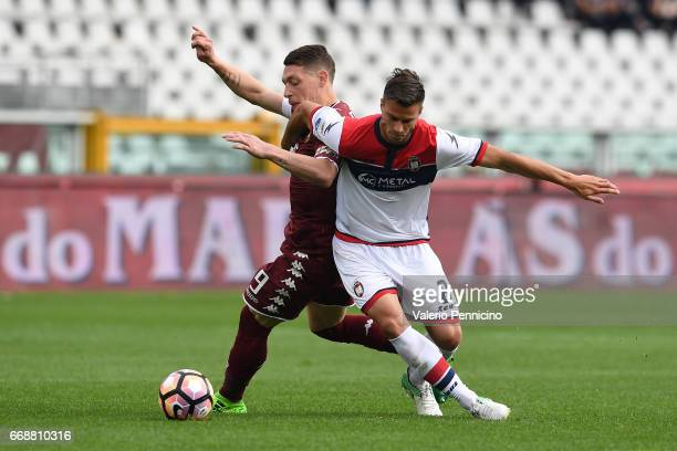 Andrea Belotti of FC Torino competes with Lorenzo Crisetig of FC Crotone during the Serie A match between FC Torino and FC Crotone at Stadio Olimpico...
