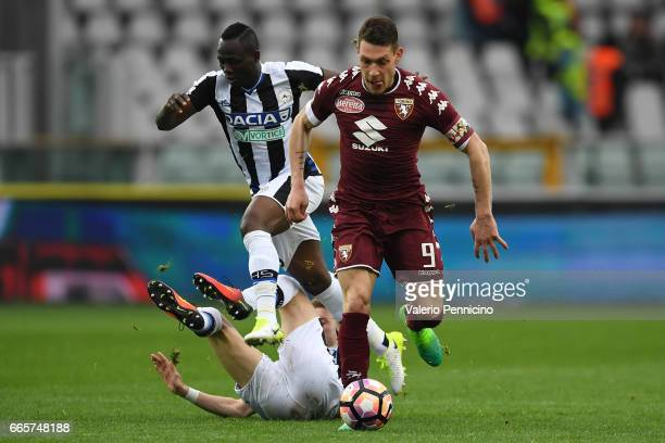 Andrea Belotti of FC Torino in action against Emmanuel Badu and Jakub Jankto of Udinese Calcio during the Serie A match between FC Torino and Udinese...
