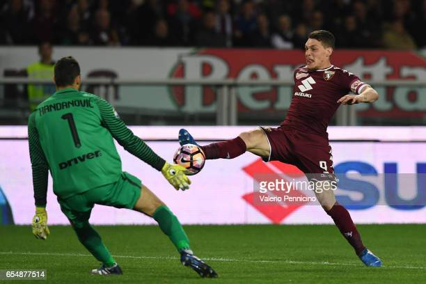 Andrea Belotti of FC Torino in action against Samir Handanovic of FC Internazionale during the Serie A match between FC Torino and FC Internazionale...