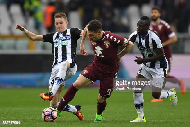 Andrea Belotti of FC Torino is challenged by Emmanuel Badu and Jakub Jankto of Udinese Calcio during the Serie A match between FC Torino and Udinese...