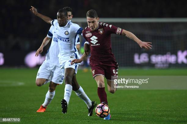 Andrea Belotti of FC Torino is challenged by Geoffrey Kondogbia of FC Internazionale during the Serie A match between FC Torino and FC Internazionale...
