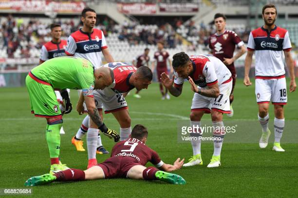 Andrea Belotti of FC Torino is contested by the FC Crotone players during the Serie A match between FC Torino and FC Crotone at Stadio Olimpico di...
