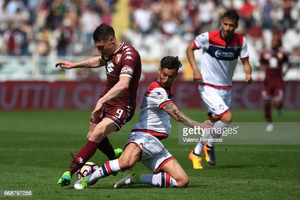Andrea Belotti of FC Torino is tackled by Federico Ceccherini of FC Crotone during the Serie A match between FC Torino and FC Crotone at Stadio...