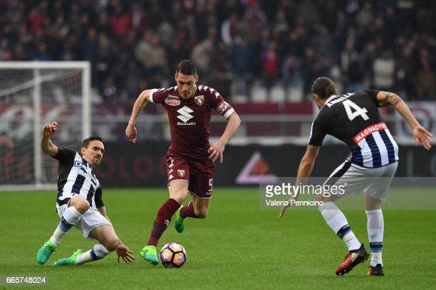 Andrea Belotti of FC Torino is tackled by Sven Kums of Udinese Calcio during the Serie A match between FC Torino and Udinese Calcio at Stadio...