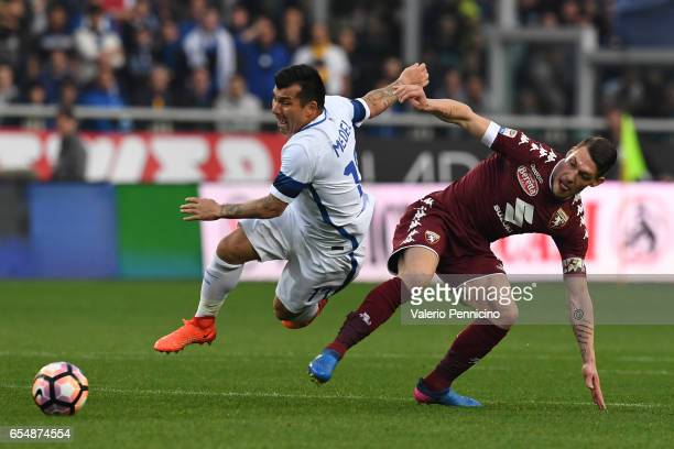 Andrea Belotti of FC Torino itackles Gary Medel of FC Internazionale during the Serie A match between FC Torino and FC Internazionale at Stadio...