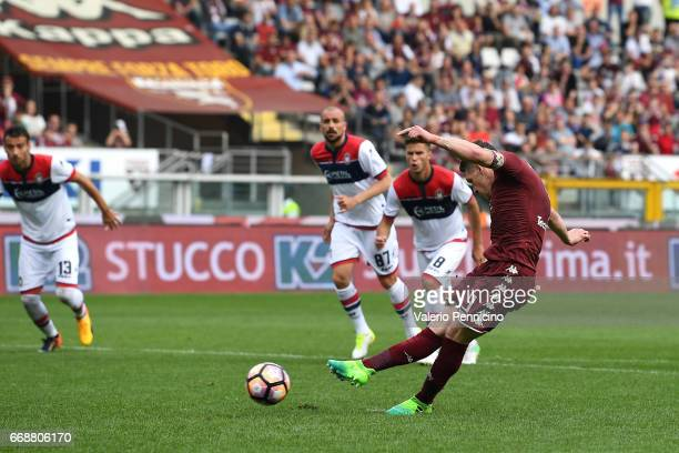 Andrea Belotti of FC Torino scores the opening goal from the penalty spot during the Serie A match between FC Torino and FC Crotone at Stadio...