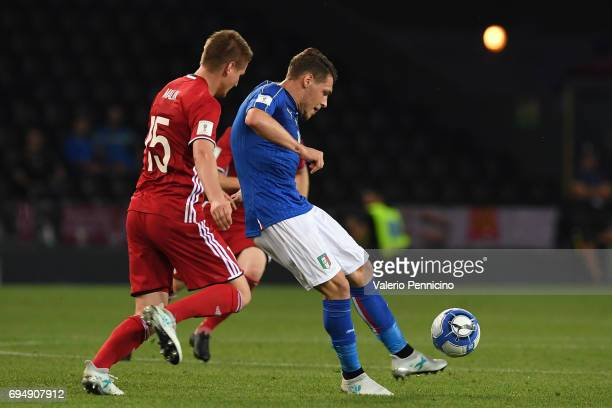 Andrea Belotti of Italy competes for the ball with Andreas Malin of Liechtenstein during the FIFA 2018 World Cup Qualifier between Italy and...