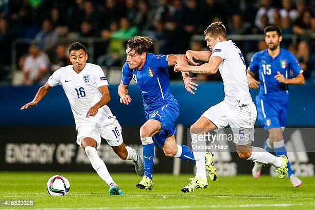 Andrea Belotti of Italy competes for the ball with Jesse Lingard and John Stones of England during the UEFA Under21 European Championship 2015 match...