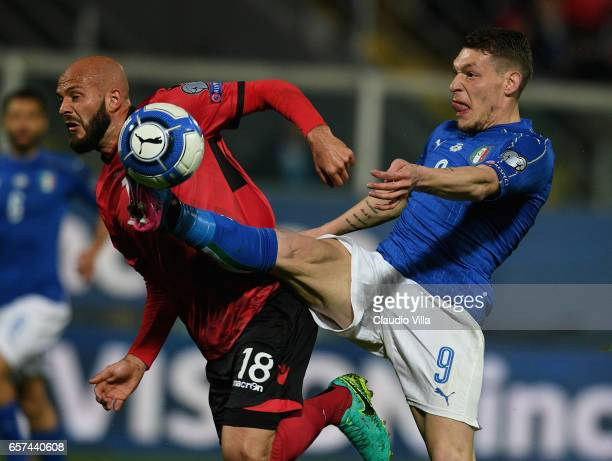 Andrea Belotti of Italy competes for the ball with Liridon Latifi of Albanial during the FIFA 2018 World Cup Qualifier between Italy and Albania at...