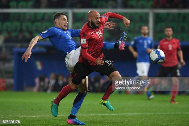 Andrea Belotti of Italy competes with Arlind Ajeti of Albania during the FIFA 2018 World Cup Qualifier between Italy and Albania at Stadio Renzo...