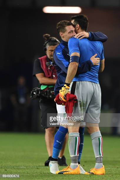 Andrea Belotti of Italy embraces Gianluigi Buffon of Italy at the end FIFA 2018 World Cup Qualifier between Italy and Liechtenstein at Stadio Friuli...
