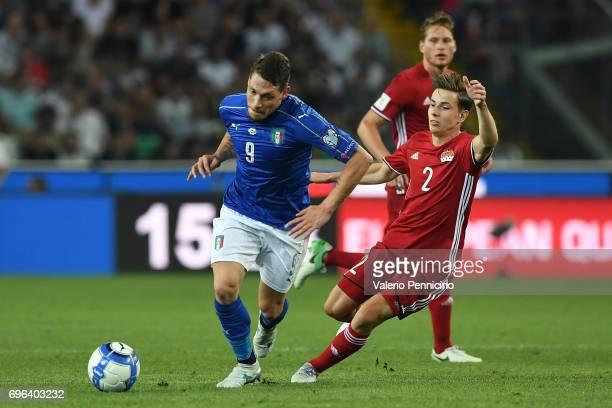 Andrea Belotti of Italy in action against Daniel Brandle of Liechtenstein during the FIFA 2018 World Cup Qualifier between Italy and Liechtenstein at...
