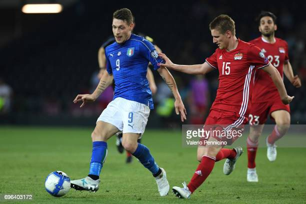 Andrea Belotti of Italy is challenged by Andreas Malin of Liechtenstein during the FIFA 2018 World Cup Qualifier between Italy and Liechtenstein at...