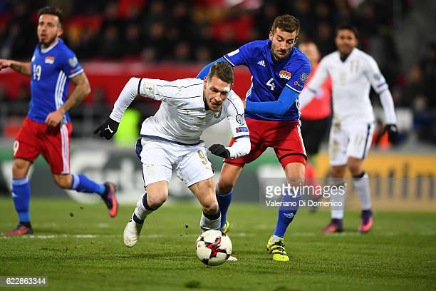 Andrea Belotti of Italy is challenged by Daniel Kaufmann of Liechtenstein during the FIFA 2018 World Cup Qualifier between Liechtenstein and Italy at...