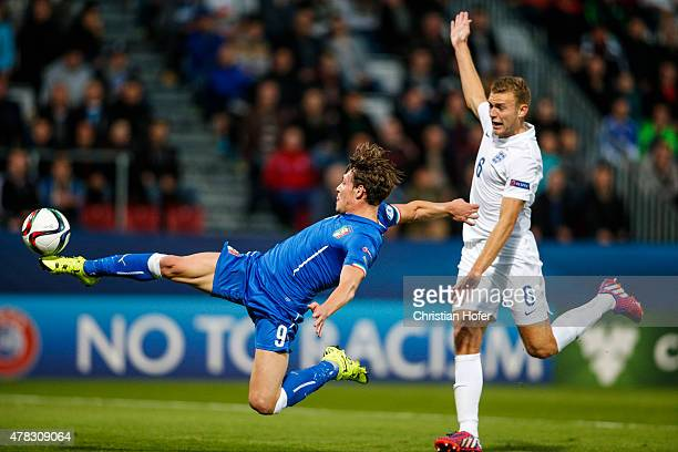 Andrea Belotti of Italy scores the first goal of Italy during the UEFA Under21 European Championship 2015 match between England and Italy at Andruv...