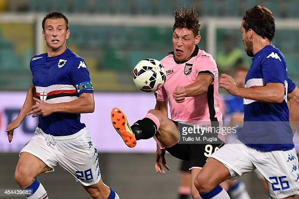 Andrea Belotti of Palermo and Daniele Gastaldello and Matias Silvestre of Sampdoria compete for the ball during the Serie A match between US Citta di...