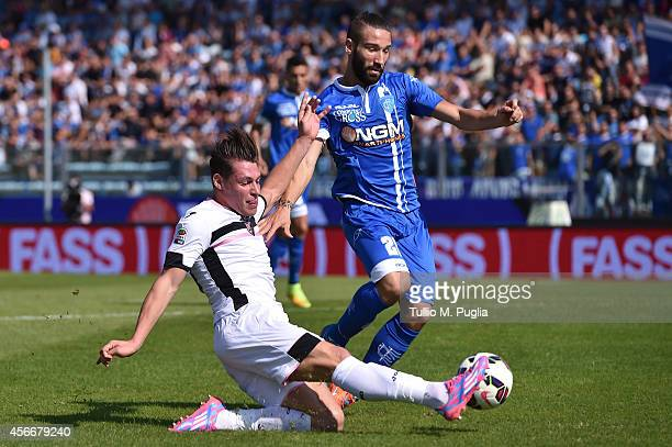 Andrea Belotti of Palermo and Mario Rui compete for the ball during the Serie A match between Empoli FC and US Citta di Palermo at Stadio Carlo...