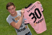 Andrea Belotti of Palermo poses with his new club shirt before his presentation as new player of US Citta di Palermo after a a Palermo training...