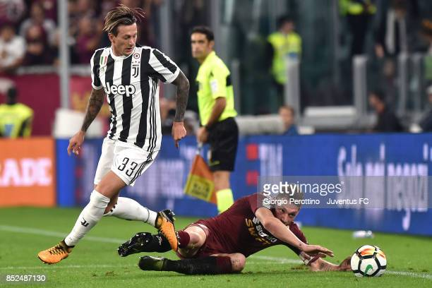 Andrea Belotti of Torino and Federico Bernardeschi of Juventus during the Serie A match between Juventus and Torino FC on September 23 2017 in Turin...