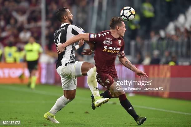 Andrea Belotti of Torino and Miralem Pjanic of Juventus competes for the ball during the Serie A match between Juventus and Torino FC on September 23...