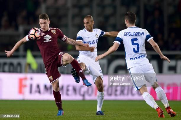 Andrea Belotti of Torino FC and Joao Miranda de Souza Filho of FC Internazionale compete for the ball during the Serie A football match between...